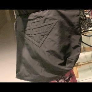 Bottega Brent's black tote bag.